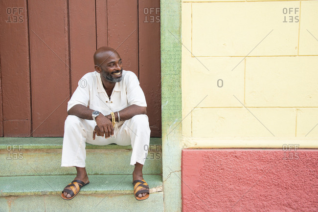 Local man relaxing outside a shop in Trinidad, Cuba