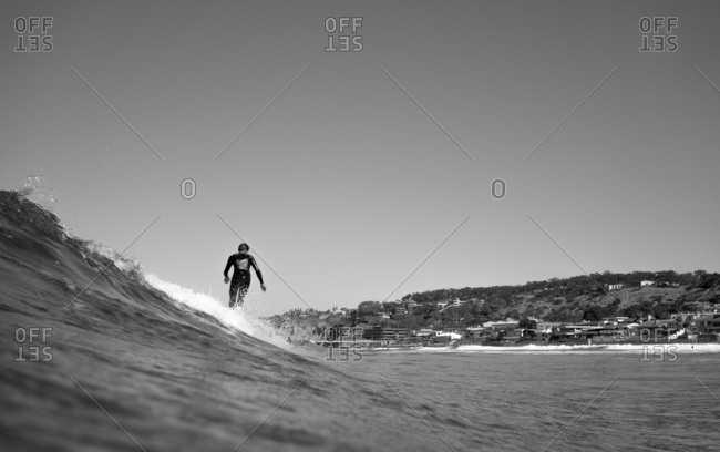 Surfer catches a wave