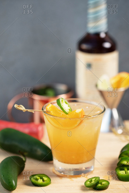 Cocktail with orange and jalapeno ingredients