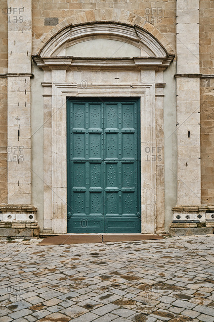 Detail of beautiful door of architectural building in Italy
