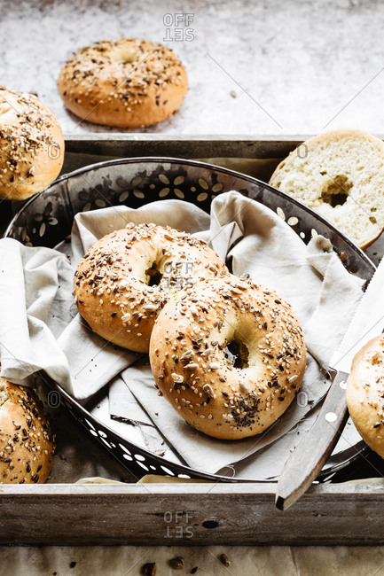 Homemade bagels on napkin into a metal tray