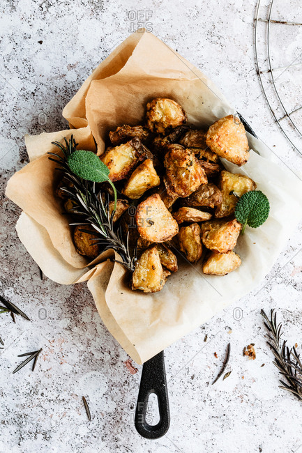 Extra crunchy roasted potatoes into a cast iron skillet