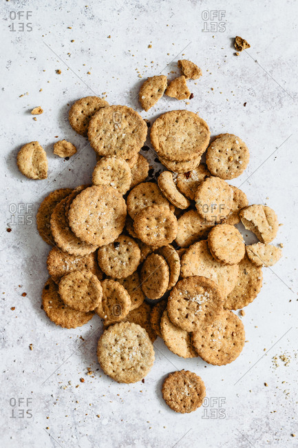 Healthy whole wheat crackers on grey surface