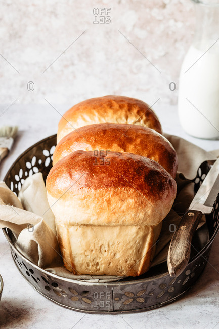 Homemade japanese milk bread onto a napkin in a baking tray
