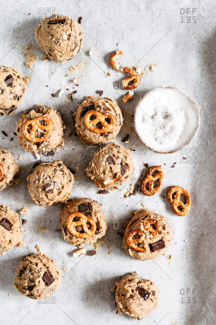 Pretzel chocolate raw cookie dough on parchment paper