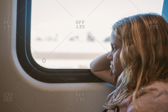 Girl on train looking out window