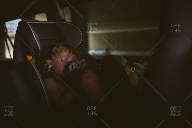 Child sleeping in carseat in car