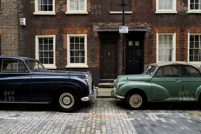 London, UK, March 2019: Two vintage cars parked on a side street