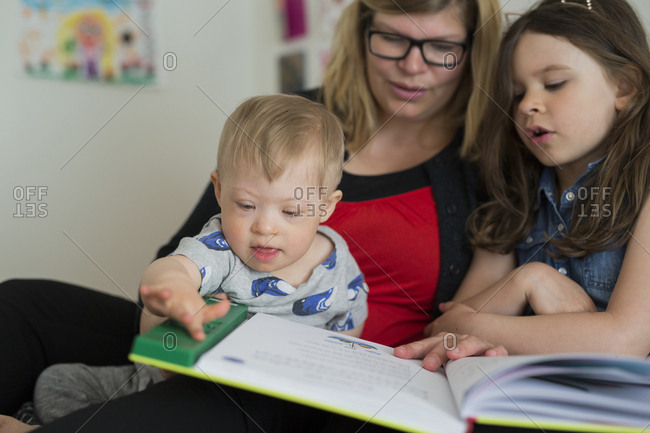Mother reading with kids