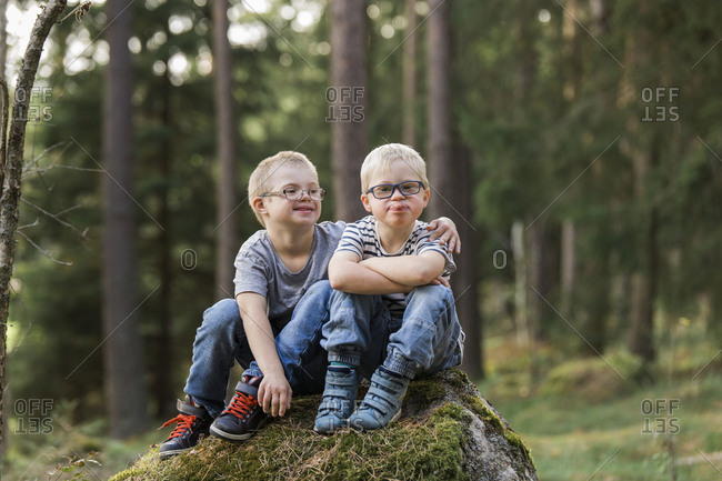 Boys posing in forest