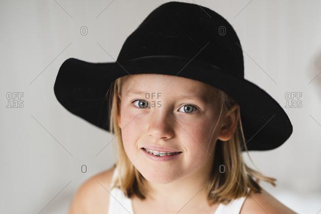 Smiling blonde girl wearing hat