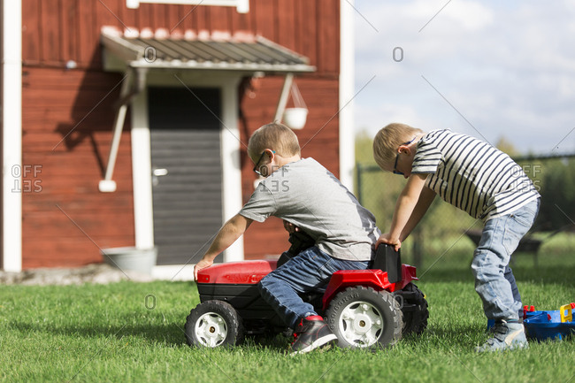 Boys playing in backyard