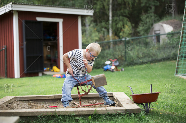 Boy playing in backyard