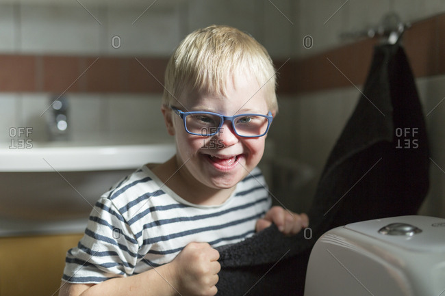 Portrait of boy in bathroom