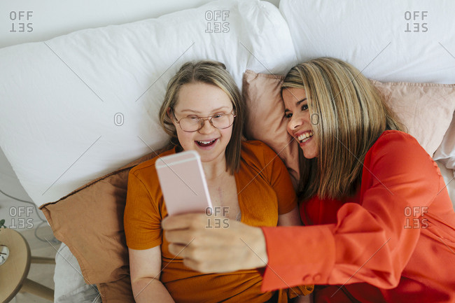 Young woman with down syndrome hanging out with girlfriend