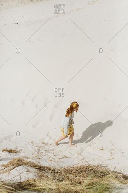Girl walking on sand