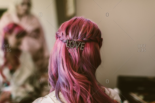 Back of a woman's head with pink hair and diamonds