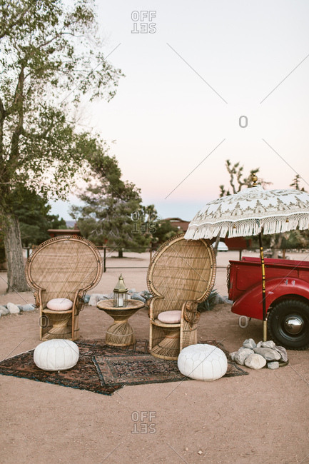 Outdoor seating area with wicker chairs in the desert