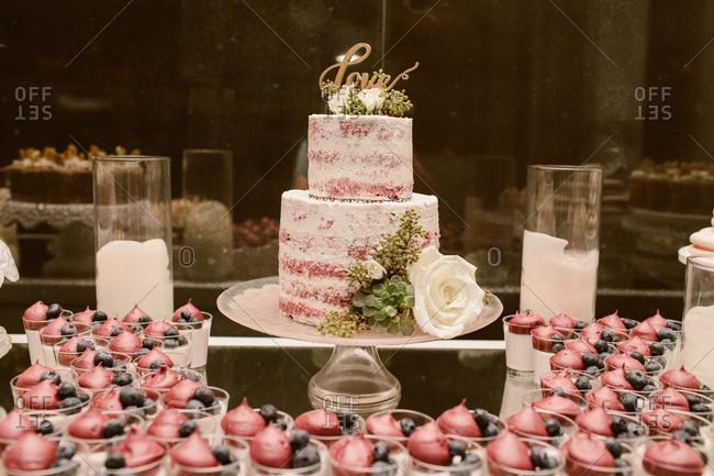 Luxury wedding dessert table with red velvet cake