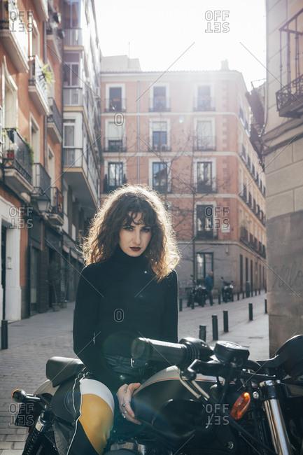 Young woman in custom motorbike