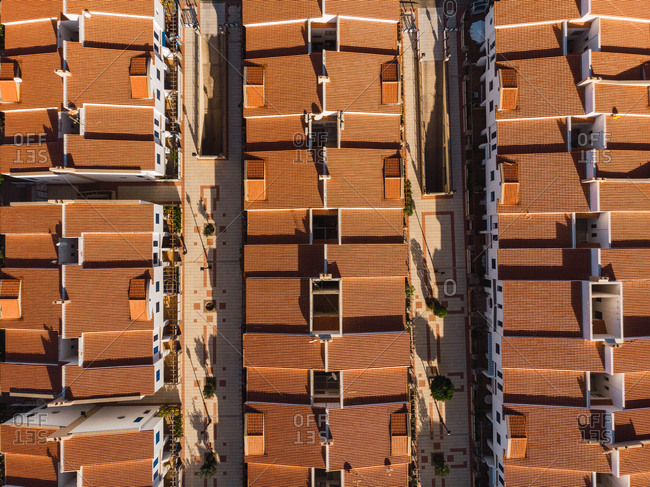 Drone top view of buildings rooftops with straight lines of streets in sunlight, Gran Canaria