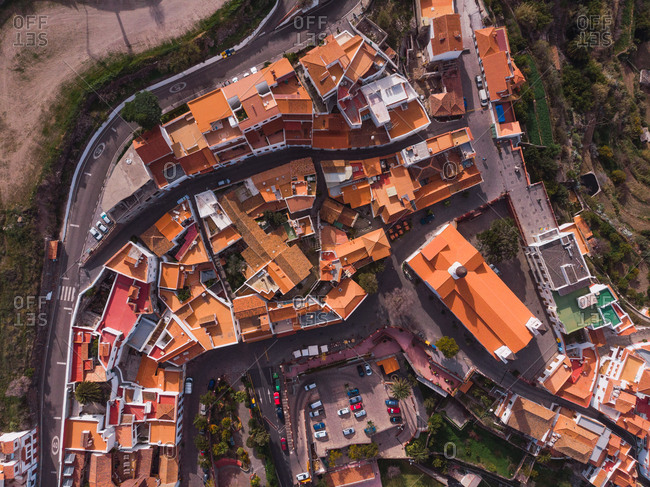 Aerial view of small town of Tejeda in valley of rocky mountains in sunlight, Gran Canaria
