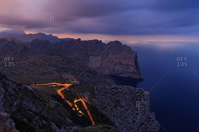 long exposure road at night between mountains