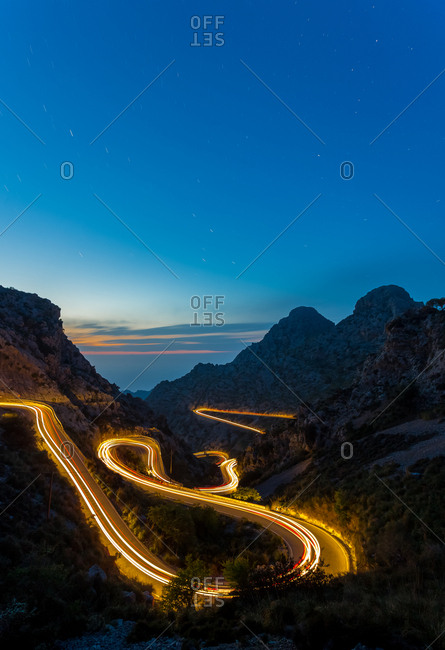 long exposure road at night between mountains