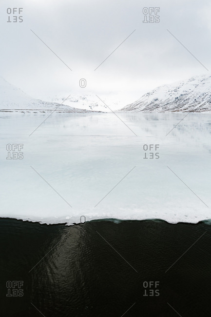 Icy mountain landscape along icy waters
