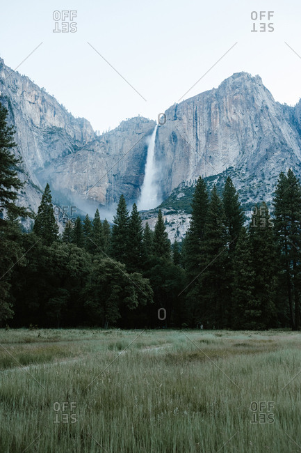 Waterfall flowing over tall cliff