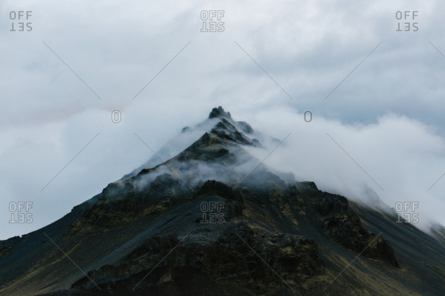 Clouds surrounding mountain peak