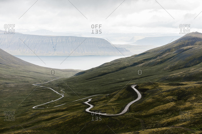 Winding road in green rolling landscape
