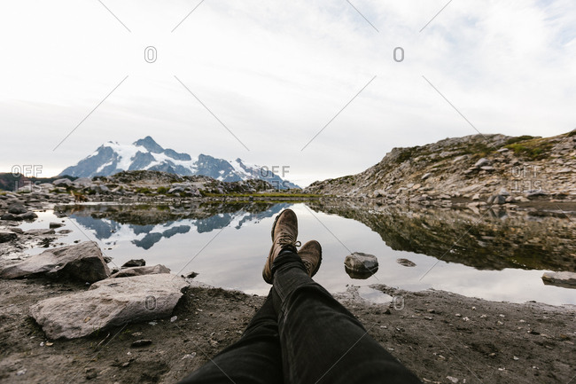 First person perspective view of a lake and mountains