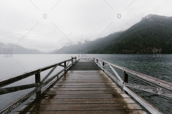 View from dock of foggy mountain landscape