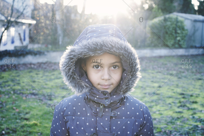 Girl wearing hooded coat, portrait