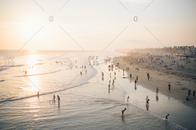 Huntington Beach, California - July 15, 2017: View from the pier overlooking the shoreline full of people and beachgoers