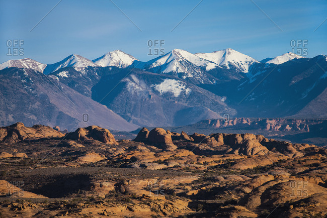 Snowcapped La Sal Mountains and sand dunes in Arches National Park, Utah, USA
