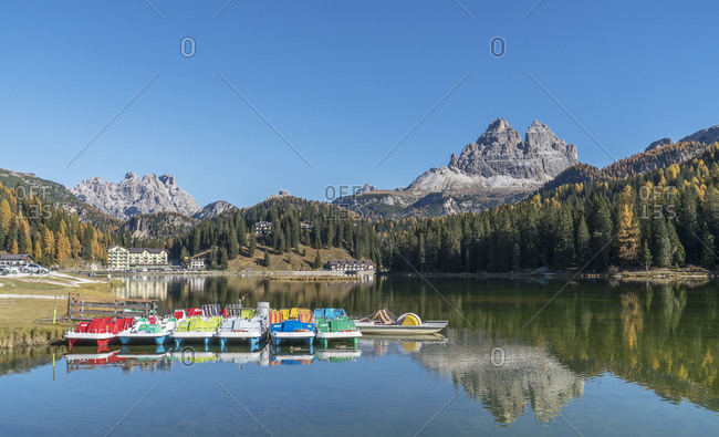 Colorful pedal boats moored on Lake Misurina in the Dolomites, South Tyrol, Italy