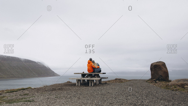 Couple sitting on picnic table