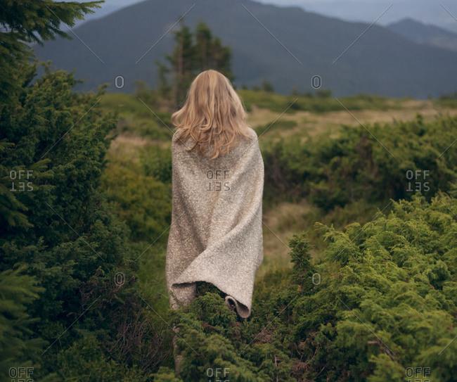 Woman wrapped in blanket in the Carpathian Mountain Range