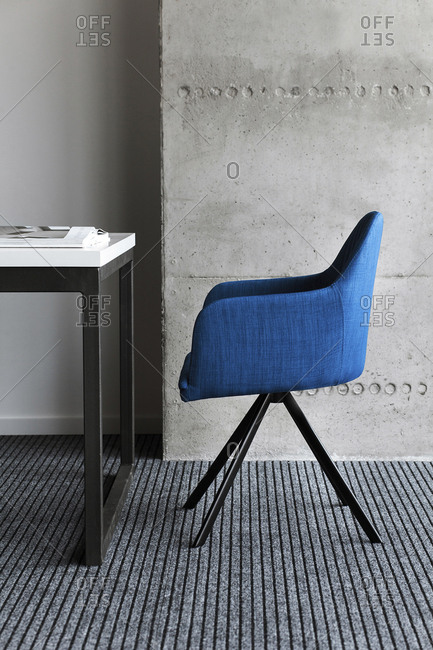Blue chair by desk