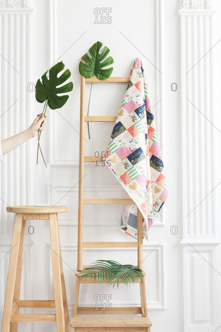 Fabric on rack with palm leaves