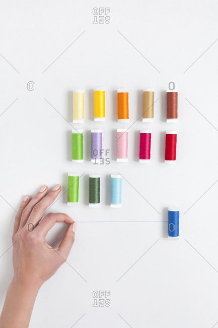 Woman's hand selecting thread