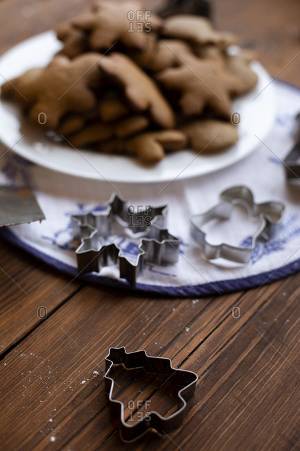 Cookie cutters by plate of Christmas cookies