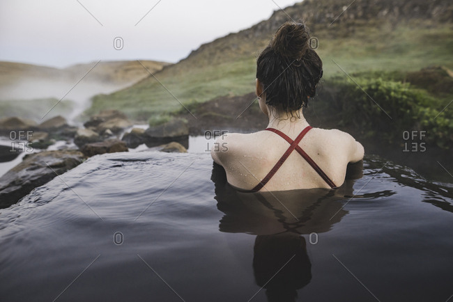 Rear view of woman in hot pool Iceland