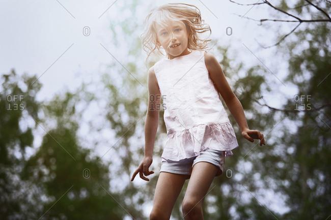 Cute girl jumping