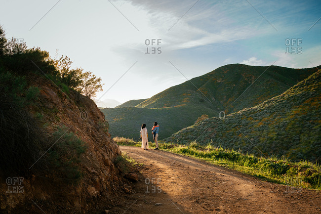 Family walking on hillside path