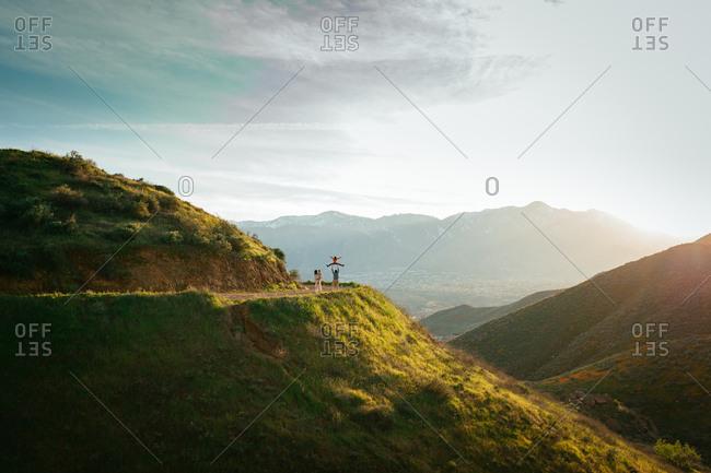 Family walking on hillside path during super bloom