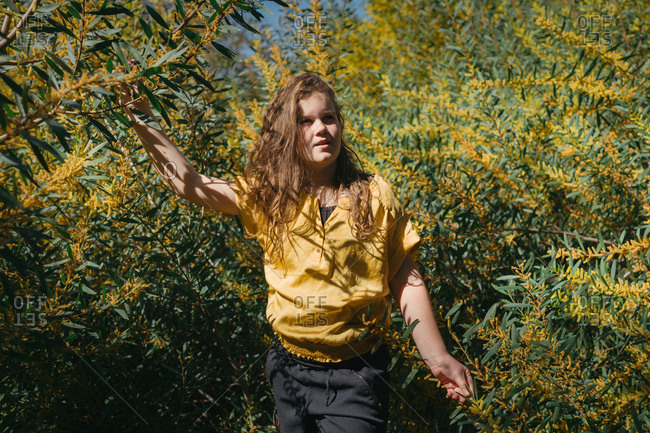 Girl surrounded by acacia plant