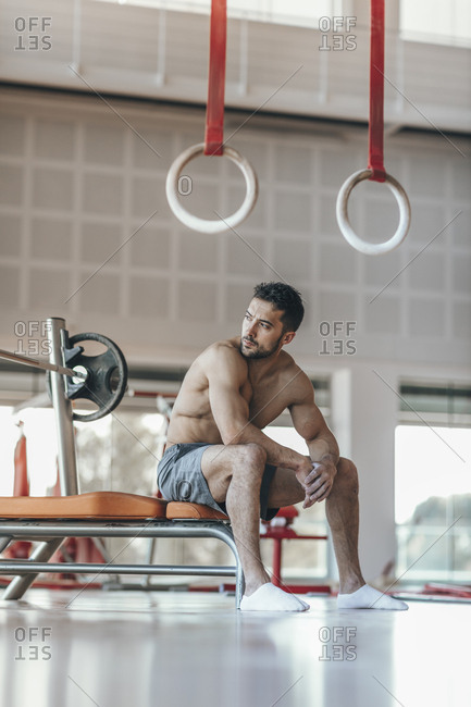 Gymnast takes a break after weight exercise